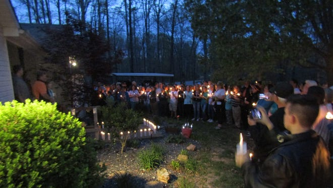 Valerie Willmore, a science teacher at Fairview High, receives support in her battle against cancer with an unexpected candlelight ceremony in her front yard Wednesday night.