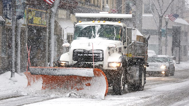 A city truck plows Main Street Tuesday afternoon after a few inches of snow fell in a short time. Tuesday February 2, 2016.