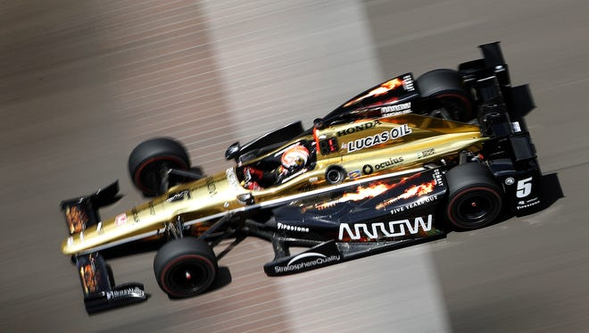 IndyCar driver James Hinchcliffe crosses the bricks early in the race during the 100th running of the Indianapolis 500 at Indianapolis Motor Speedway on May 29, 2016.