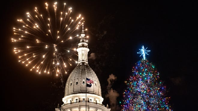 Fireworks explode over the Capitol and the lit Christmas tree during Silver Bells in the City on Friday, November 17, 2017, in downtown Lansing.