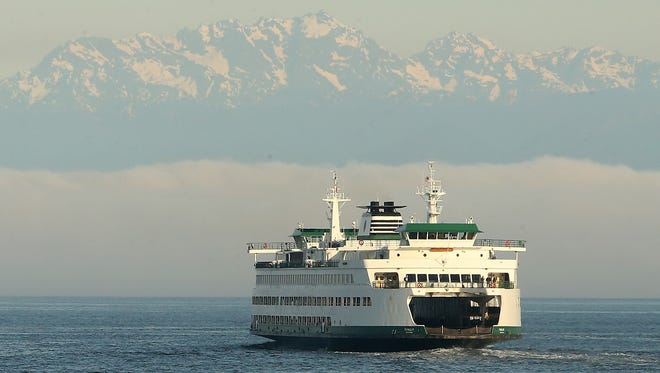 FILE PHOTO - The Washington State Ferry Puyallup heads from Seattle to Bainbridge Island on Tuesday, May 8, 2018.