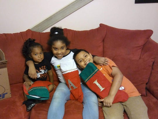 Issac Santillan died in a crash early Christmas morning, which was also his 9th birthday. The girls in the photo with Issac are Aryanna and Noah Santillan. The photo was taken on Christmas Eve.