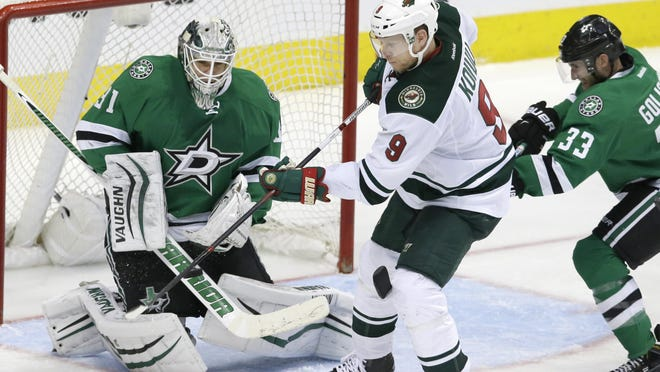 Minnesota Wild center Mikko Koivu (9) scores a goal against Dallas Stars goalie Antti Niemi (31) and defenseman Alex Goligoski (33) during overtime in Game 5 in the first round of the NHL Stanley Cup playoffs Friday in Dallas. The Wild won 5-4.
