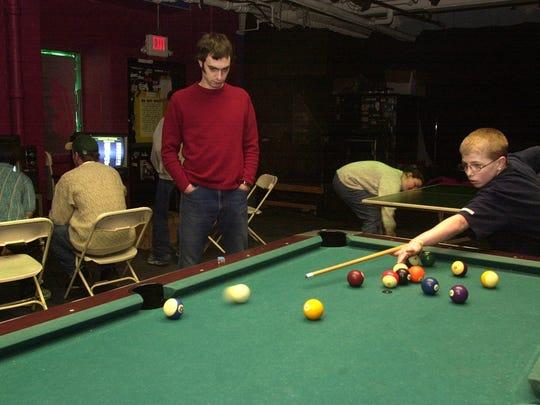 Daryl Rabidoux, left, a staff member at 242 Main, plays