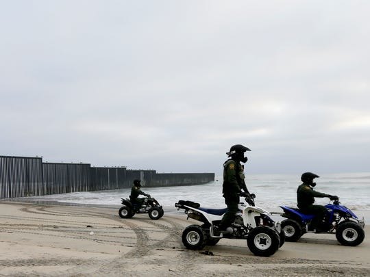 In this June 22, 2016 photo, Border Patrol agents ride