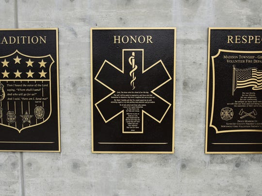 Plaques honoring first responders are featured at the new Public Service Safety Memorial in Gibsonburg being dedicated on the 15th anniversary of the Sept. 11, 2001 terrorist attacks.