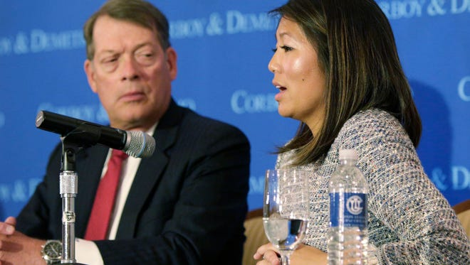 """Crystal Pepper daughter of Dr. David Dao accompanied by attorney Stephen Golan, speaks at a news conference Thursday, April 13, 2017, in Chicago. Dao a passenger dragged from a United Express flight Sunday April 9, 2017, suffered a """"significant"""" concussion and broken nose, and he lost two front teeth, attorney Thomas Demetrio said Thursday. Dao was removed from the plane after he refused to give up his seat on the full flight from Chicago to Louisville to make room for four crew members.(AP Photo/Teresa Crawford)"""