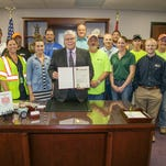 Mayor Bob Stephens proclaimed May 17-23 as National Public Works Week in Springfield at a ceremony Monday. The ceremony was attended by top representatives from the City's Public Works and Environmental Services departments. Back row, from left: Brian Doubrava, James Choates, Brian Adams, Michael Tucker. Middle row: Chris Dunnaway, Sonny Decker, Louie Morrow, Taylor Moore, Josh Gage, Mark Seery. Front Row: Jonathan Peitz, Kellie Herman, Emily Wagner, Mayor Bob Stephens, Wayne Lorance, Jennifer Duzan, Jason Foss.