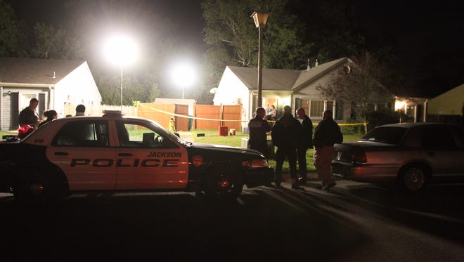 Police at the scene of Jackson home.