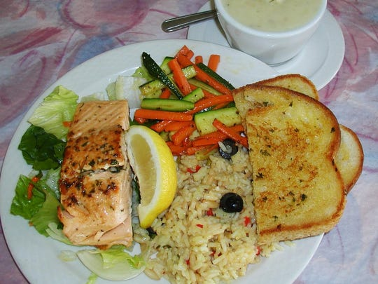 The salmon special on Fridays come with filet, sauteed vegetables, rice cooked in chicken broth, grilled and buttered sourdough bread and choice of clam chowder or salad.