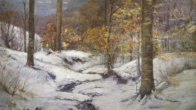 """An oil painting by T.C. Steele titled """"Winter in the Ravine"""" Friday, May 13, 2016, at the Art Museum of Greater Lafayette."""