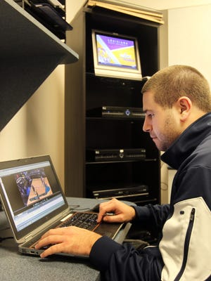 As video coordinator for Xavier's men's basketball team, Ty Sampson edits all the video shot of the team and tracks down opponents' games.