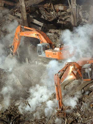 In this Oct. 2001 file photo, excavation equipment works to uncover hot spots at the still smoldering World Trade Center.