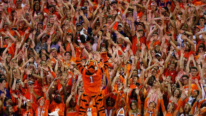 The Clemson Tigers mascot cheers with fans during the fourth quarter against the Auburn Tigers at Clemson Memorial Stadium.