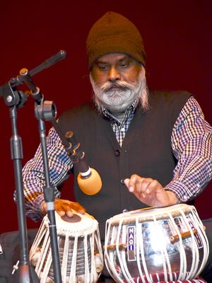Rajinder Singh of Sikh Temple of the Fox Valley performs at the Interfaith Festival of Gratitude in Oshkosh.