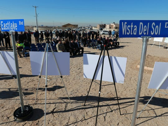 People gather in a lot at Mission Ridge Boulevard and Paseo del Este Drive for a groundbreaking ceremony for eight major road projects Tuesday.