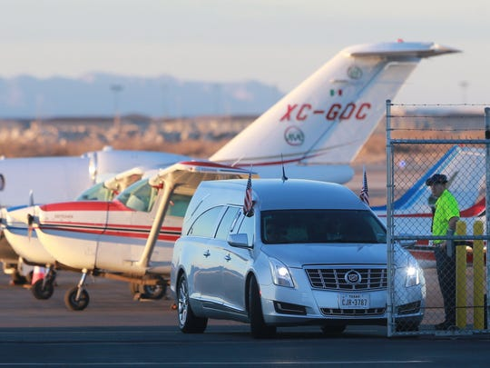 The hearse which transported the body of Supreme Court Justice Antonin Scalia leaves the Atlantic Aviation hangar Sunday.