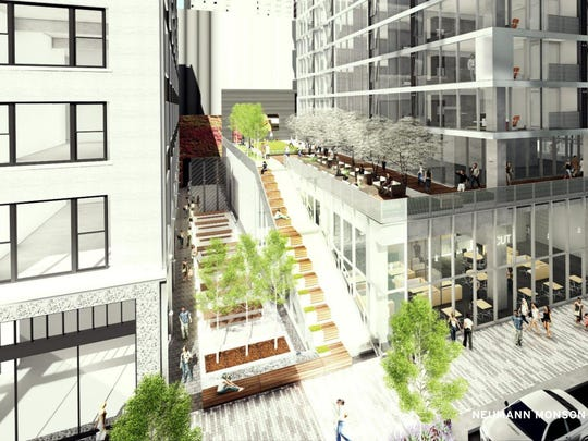 This is a rendering of The Blackbird's street and skywalk level. The 33-story apartment tower is planned to open in downtown Des Moines in December 2019.