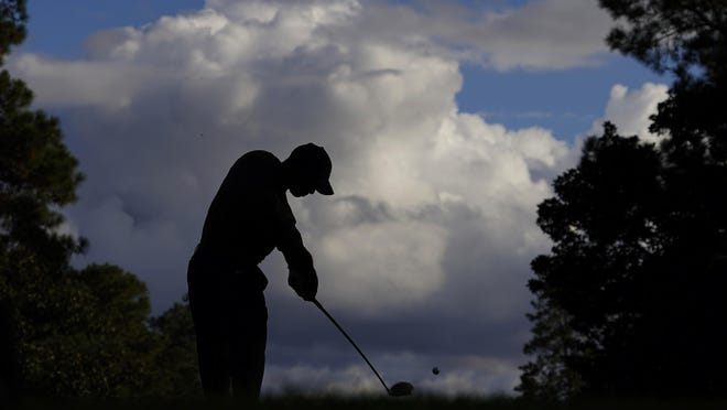 Tiger Woods tees off on the ninth hole during the first round of the Masters Thursday, Nov. 12, 2020, in Augusta, Ga.