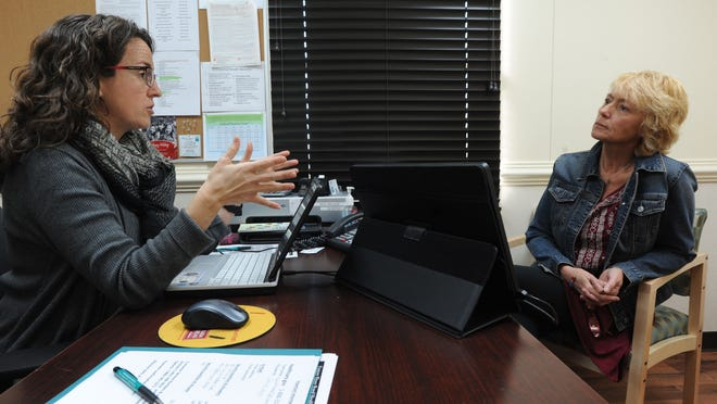 Eastern Shore Rural Health Outreach & Enrollment Coordinator Meghan Neville, left, speaks with her client, Caroline Hale, about health insurance options in 2014. The deadline for signing up for 2018 is Dec. 15.