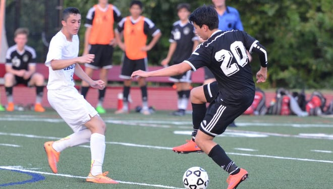 Rye's Tommy Gates (20) takes on a defender in a 2-1 win at Eastchester on Tuesday, Sept. 8.