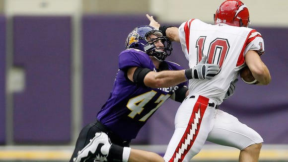 Former Northern Iowa linebacker, Josh Mahoney, left, was recently named to the UNI athletic hall of fame. Mahoney was a star two-way player for O'Gorman High.