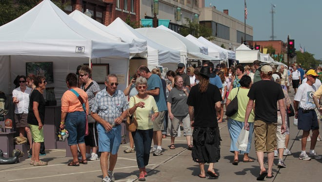 Third Street in downtown Wausau is crowded with art, artists and art fans Saturday during Wausau's Artrageous weekend.