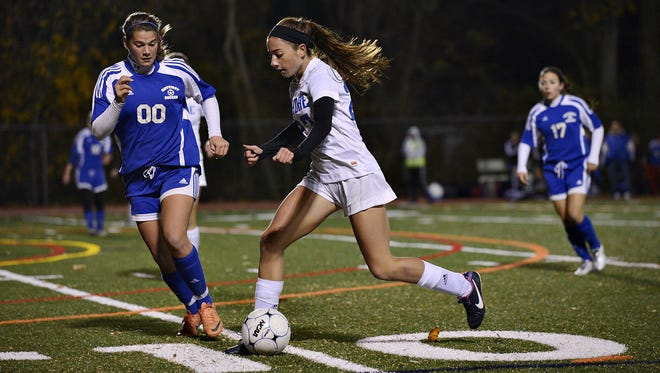 Shore Regional's Devon McDonough (center) goes on the attack as Gateway's Mackell Shultes (left) defends during the first half of the NJSIAA state soccer semifinal at Haddonfield Memorial High School on Tuesday November 19, 2013. Shore defeated Gateway 3-0.
