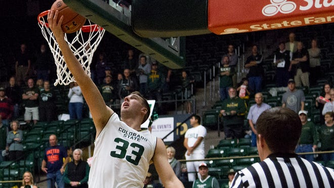 CSU's Braden Koelliker scores two of his game-21 points during the Rams' 64-61 win Sunday over New Mexico State.