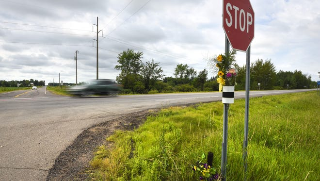 Flowers and painted markers on Minnesota Highway 23  near Foreston are a reminder of a fatal collision that occurred in 2016.