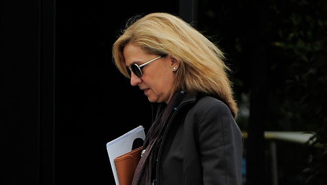 In this April 5, 2013 file photo, Spain's Princess Cristina walks toward her office in Barcelona, Spain. A Spanish judge on Monday Dec. 22, 2014 has ordered Princess Cristina to be tried along with her husband on charges of tax fraud, marking the first time that a member of the country's royal family heads to court since the royalty was restored in 1975. The legal troubles of King Felipe VI's sister during a four-year probe have damaged the Spanish monarchy's image.