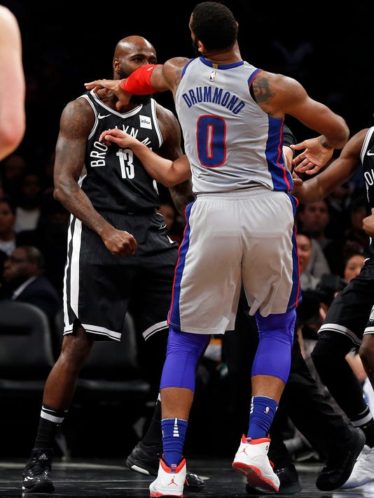 Detroit Pistons center Andre Drummond (0) pushes Brooklyn Nets forward Quincy Acy (13) during the second half of an NBA basketball game Sunday, April 1, 2018, in New York. Both Drummond and Acy were ejected as a result of the play. The Pistons defeated the Nets 108-96. (AP Photo/Adam Hunger)