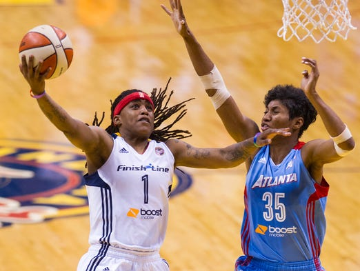 Indiana Fever's Shavonte Zellous (1) puts up a shot around the defense of Atlanta Dream's Angel McCoughtry (35) during the second half of a WNBA basketball game, Saturday, July 12, 2014, at Bankers Life Fieldhouse in Indianapolis. Atlanta defeated the Fever 93-74.