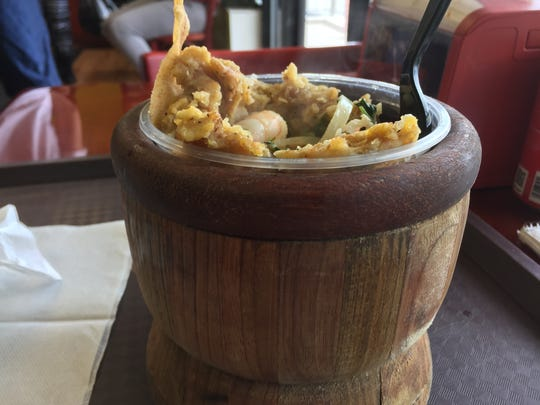 "Mofongos such as the ""Camarones Al Ajillo o En Salsa,"" or shrimp with sauce or garlic, are served in large wooden pilons inside Sabor Criollo."