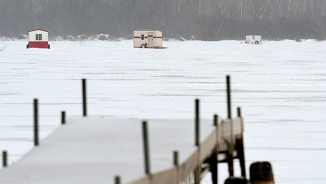 Docks and boats line the shore of Little Rock Lake as fish houses dot the lake Thursday, Jan. 5, near Rice.The DNR is postponing a drawdown of the lake to help reduce phosphorus and improve water quality until 2018.