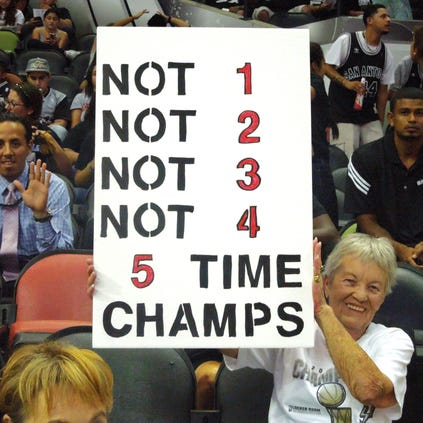 Spurs fan Patsy Wingfield shows her support for the team with a sign at Wednesday night's open scrimmage at the AT&T Center.