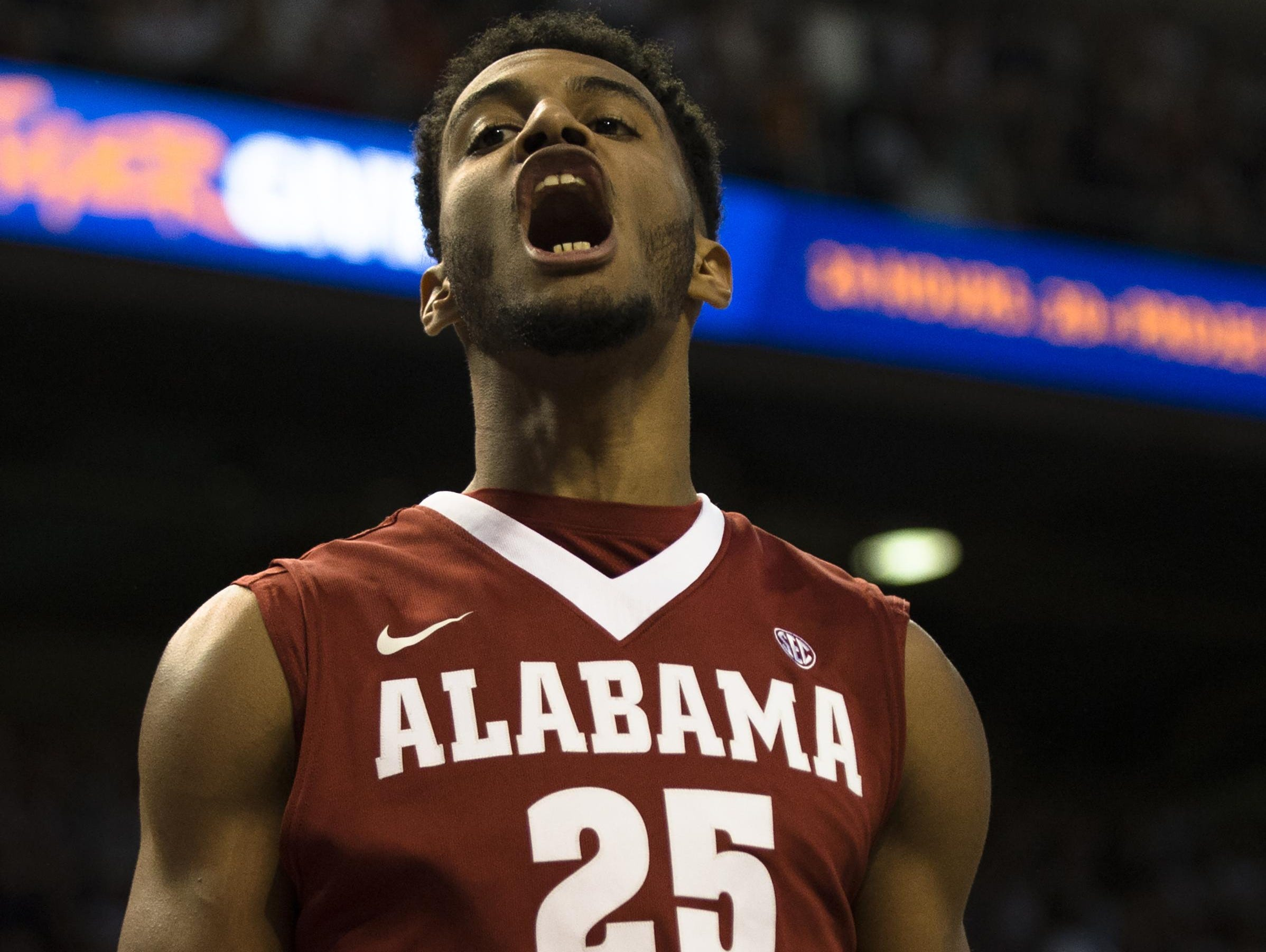 Alabama's Braxton Key (25) screams after scoring during the NCAA Basketball game between Auburn and Alabama on Saturday, Jan. 21, 2017, at Auburn Arena in Auburn, Ala.
