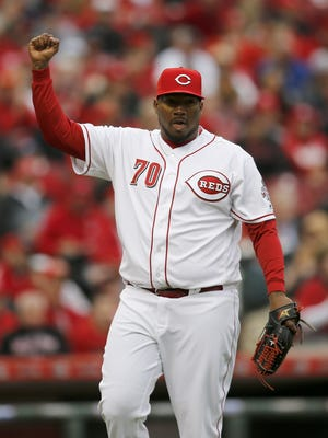 Reds relief pitcher Jumbo Diaz pumps his fist after escaping an inning on Opening Day.
