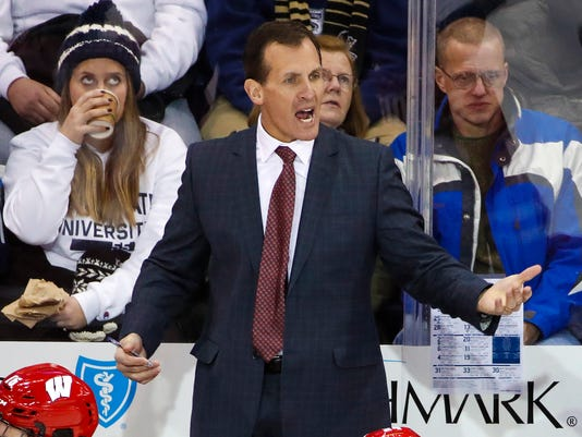 """FILE - In this Jan. 5, 2018, file photo, Wisconsin coach Tony Granato stands behind his bench during the team's NCAA hockey game against Penn State in State College, Pa. Granato, coach of the U.S. men's team for the Olympics, said the U.S. """"has lots of pieces that other teams and countries don't know about"""" and wonders if his team will be overlooked. (AP Photo/Gene J. Puskar, File)"""