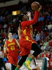 Middleton's Abbey Webber tries to stop Divine Savior Holy Angels' Arike Ogunbowale as she drives to the basket during the first half of their Division 1 semifinal.