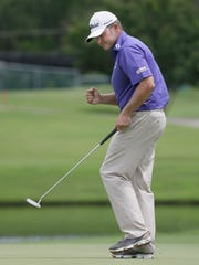 Jason Bohn reacts to sinking his putt on the 16th hole during the final round of the Colonial golf tournament, Sunday, May 24, 2015, in Fort Worth, Texas. (AP Photo/LM Otero)