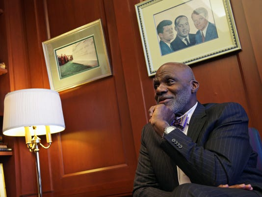 In this Jan 15, 2015, photo, Minnesota Supreme Court Justice Alan Page talks during an interview in his chambers in St. Paul, Minn. Page, known as an NFL Hall of Famer with the Minnesota Vikings' Purple People Eaters defensive line from the late 1960s into the late 70s, has spent 22 years as the first black justice on the state's highest court. That chapter will come to an end in August when he hits the mandatory retirement age of 70. (AP Photo/Jim Mone)