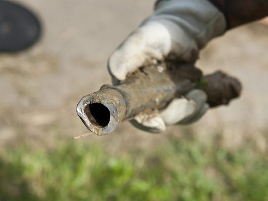 A section of lead pipe was removed by crews replacing lead service lines at homes in Flint in August.