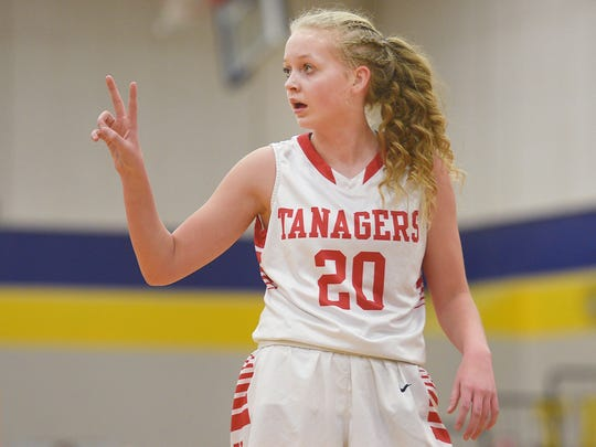 Vermillion's Lexi Plitzuweit communicate with her coach