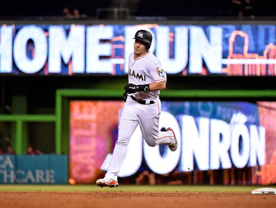J.T. Realmuto of the Marlins rounds the bases after a home run against the Phillies on Sept. 4.