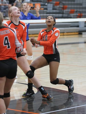 Grinnell's Naomi Jackson, 10, reacts as the Tigers get set to return the ball against Clear Creek Amana during the Grinnell Tournament on Saturday, Aug. 26.