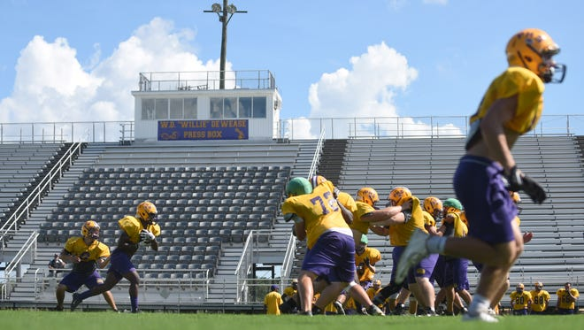Purvis High School players run plays during practice before the start of the season on Wednesday.