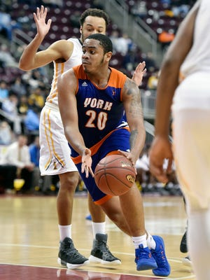 York High's Marquise McClean drives against Milton Hershey in the second half of the PIAA District 3 Class 5A boys' basketball championship game Thursday, March 1, 2018, at the Giant Center. York High lost 69-62 to Milton Hershey in the Bearcats' fifth district championship game since 2010.