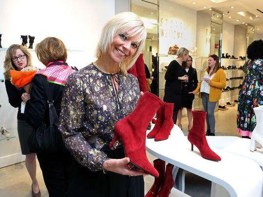 Avril Graham, executive fashion and beauty editor at Harper's Bazaar, recommends the Clingy red sock bootie from Stuart Weitzman during a fashion event at The Westchester in White Plains Oct. 26, 2017.