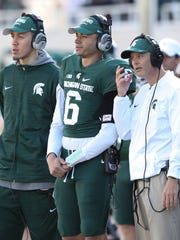 Michigan State quarterback Damion Terry, center, never